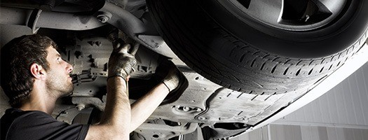 CLUTCH REPAIR AND REPLACEMENT Watford and Hertfordshire -mechanic inspecting car clutch
