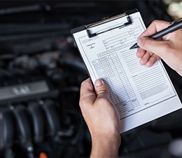 mechanic with a checklist